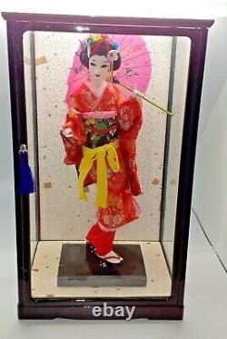 Japanese geisha doll in glass/wood display case